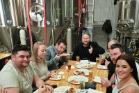 Group at Burra brewery enjoying craft beer and pizza